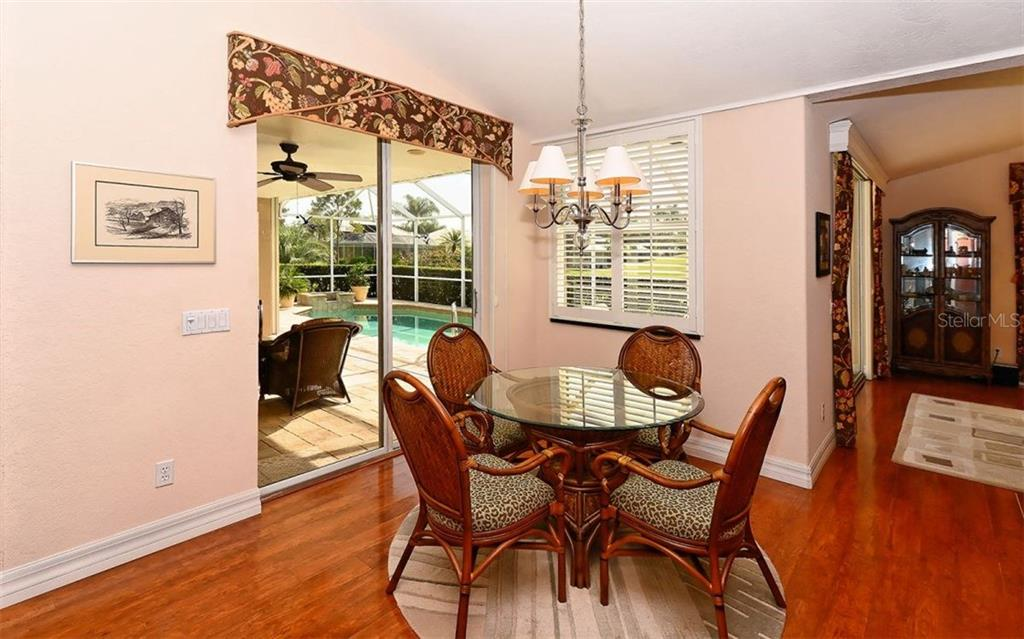 Dinette with sliders to lanai/pool - Single Family Home for sale at 571 Khyber Ln, Venice, FL 34293 - MLS Number is A4210343