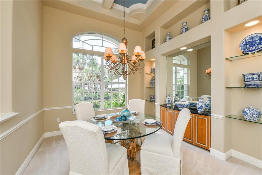 Perpetually sunny Dining Room. - Single Family Home for sale at 5585 Siesta Estates Ct, Sarasota, FL 34242 - MLS Number is A4211109