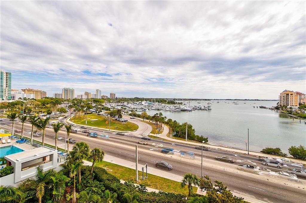 Dining Room & Den Overlooking Balcony and Marina Jack (Photos are Virtually Staged) - Condo for sale at 1111 N Gulfstream Ave #7b, Sarasota, FL 34236 - MLS Number is A4212040