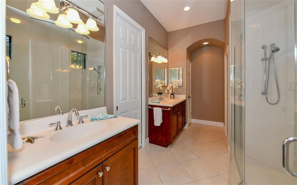 Laundry room with utility sink, folding counter and shelf. - Single Family Home for sale at 7325 Wexford Ct, Lakewood Ranch, FL 34202 - MLS Number is A4212155