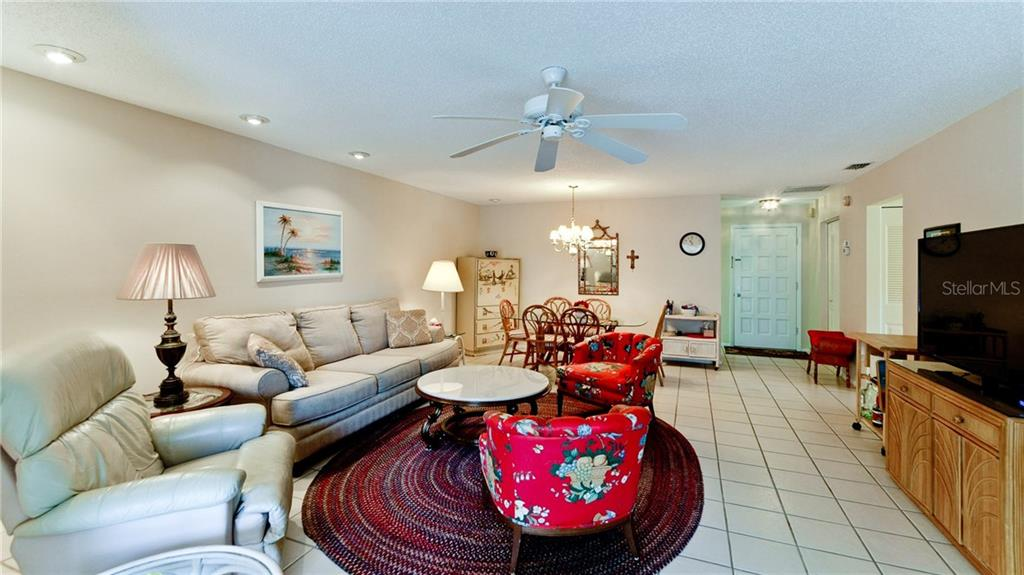Living room/dining room combined. - Condo for sale at 5107 29th St W #n/A, Bradenton, FL 34207 - MLS Number is A4213034