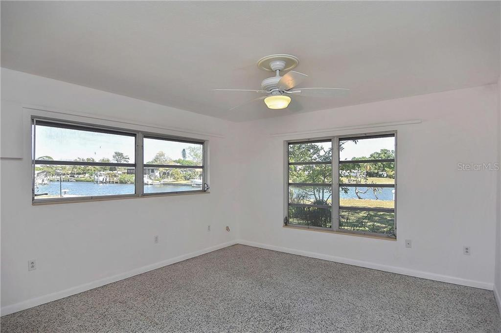 Master bedroom with canal views - Single Family Home for sale at 1953 Fairview Dr, Englewood, FL 34223 - MLS Number is A4213338