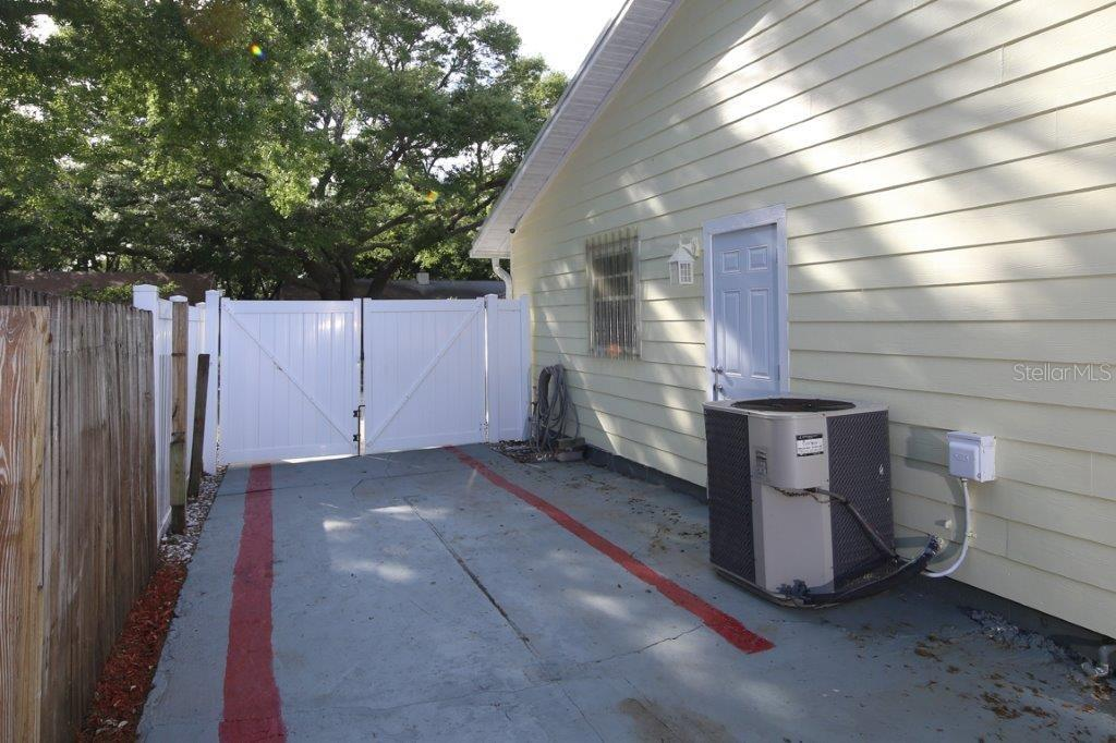 Extra drive space behind the fence to park your boat, trailer or work vehicle. - Single Family Home for sale at 4417 Garcia Ave, Sarasota, FL 34233 - MLS Number is A4213473