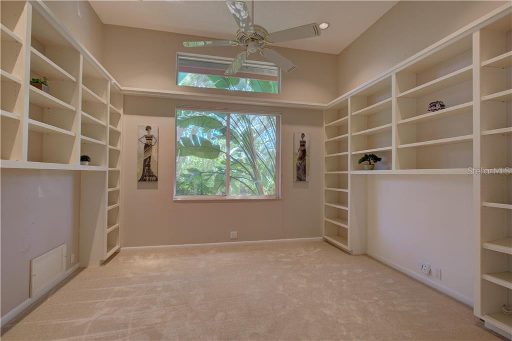 Generous office with built in bookcases - Single Family Home for sale at 3896 Boca Pointe Dr, Sarasota, FL 34238 - MLS Number is A4213831