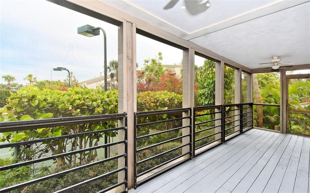 Screened porch overlooking tennis court - Condo for sale at 3440 Gulf Of Mexico Dr #8, Longboat Key, FL 34228 - MLS Number is A4214047