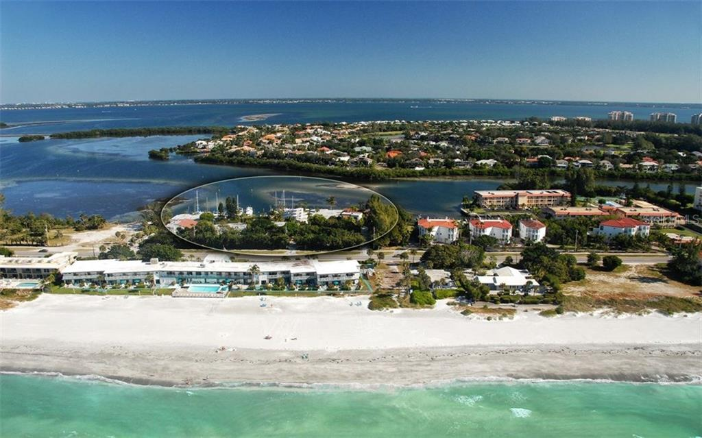 Aerial view of the Dock on the Bay complex - Condo for sale at 3440 Gulf Of Mexico Dr #8, Longboat Key, FL 34228 - MLS Number is A4214047