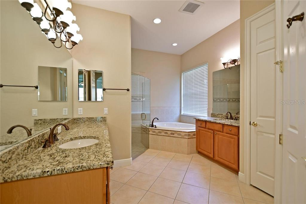 Master Bath with the convenience of separate vanities and sinks.  Separate decorative shower and tub. - Single Family Home for sale at 3729 Summerwind Cir, Bradenton, FL 34209 - MLS Number is A4215992