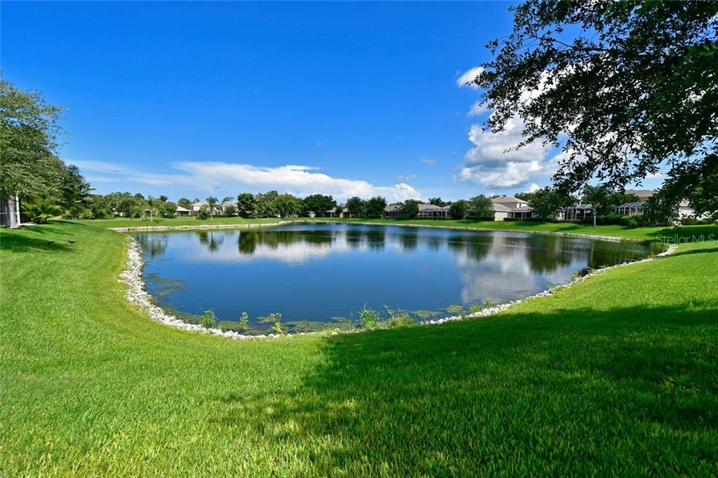 Tranquil lake views can be enjoyed from the Master Bedroom, Great room, and Eat In Kitchen area. - Single Family Home for sale at 3729 Summerwind Cir, Bradenton, FL 34209 - MLS Number is A4215992