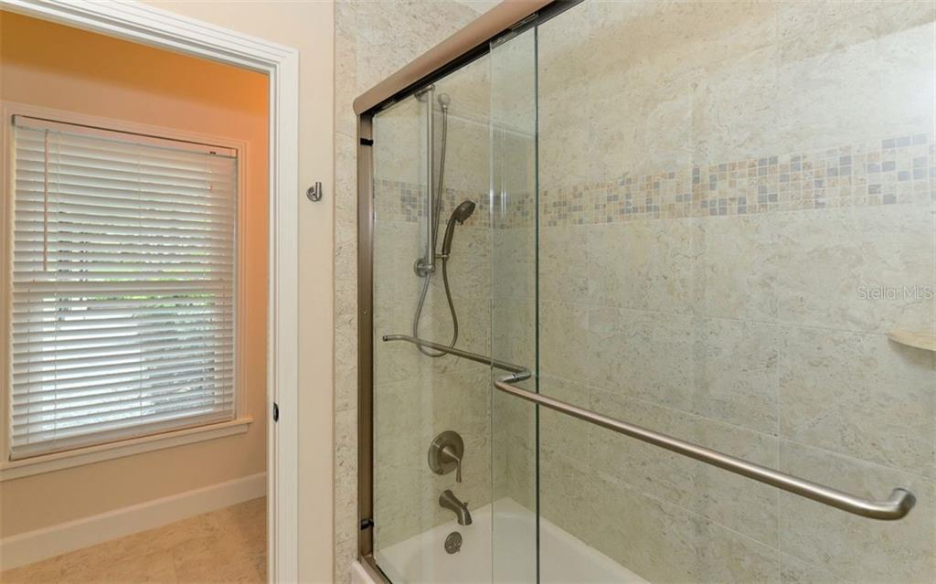 Full Guest Bathroom - Single Family Home for sale at 1670 Bay View Dr, Sarasota, FL 34239 - MLS Number is A4400079