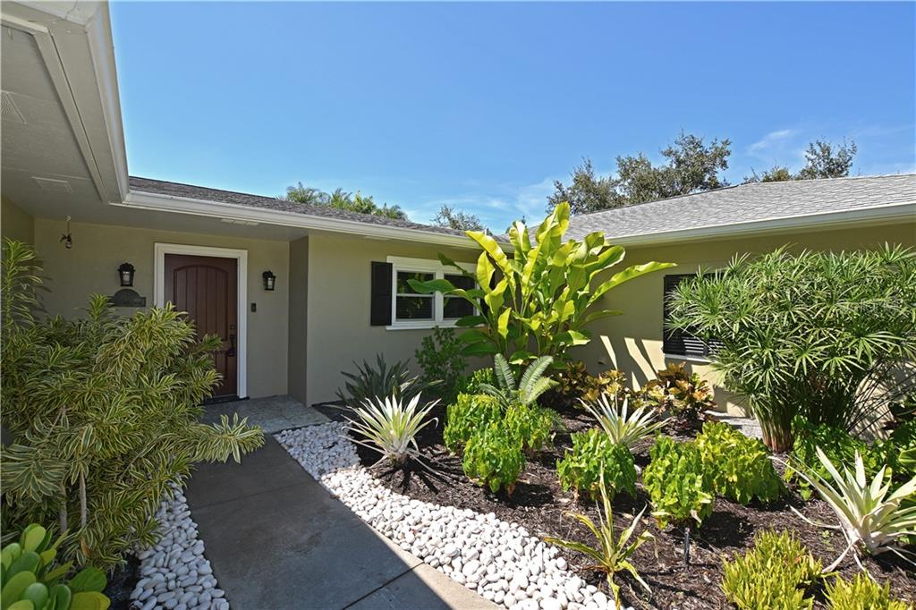 Great curb appeal with tropical foliage. - Single Family Home for sale at 1670 Bay View Dr, Sarasota, FL 34239 - MLS Number is A4400079