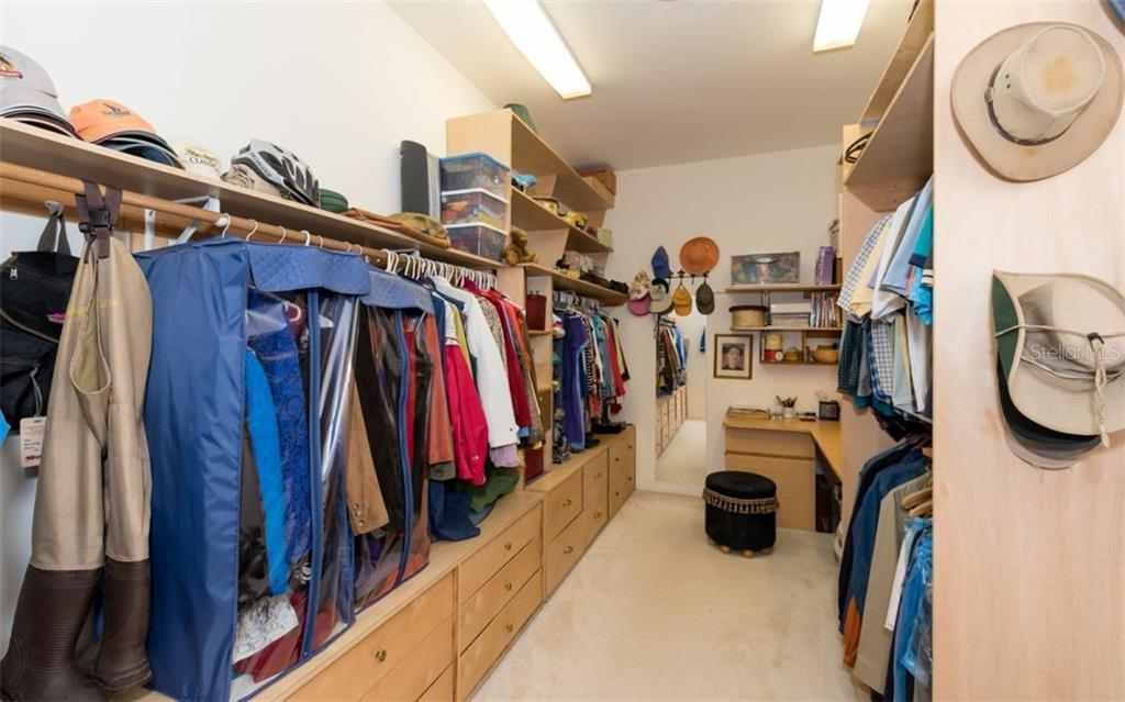 Main House Master Bedroom Closet - Single Family Home for sale at 7865 27th St E, Sarasota, FL 34243 - MLS Number is A4400492