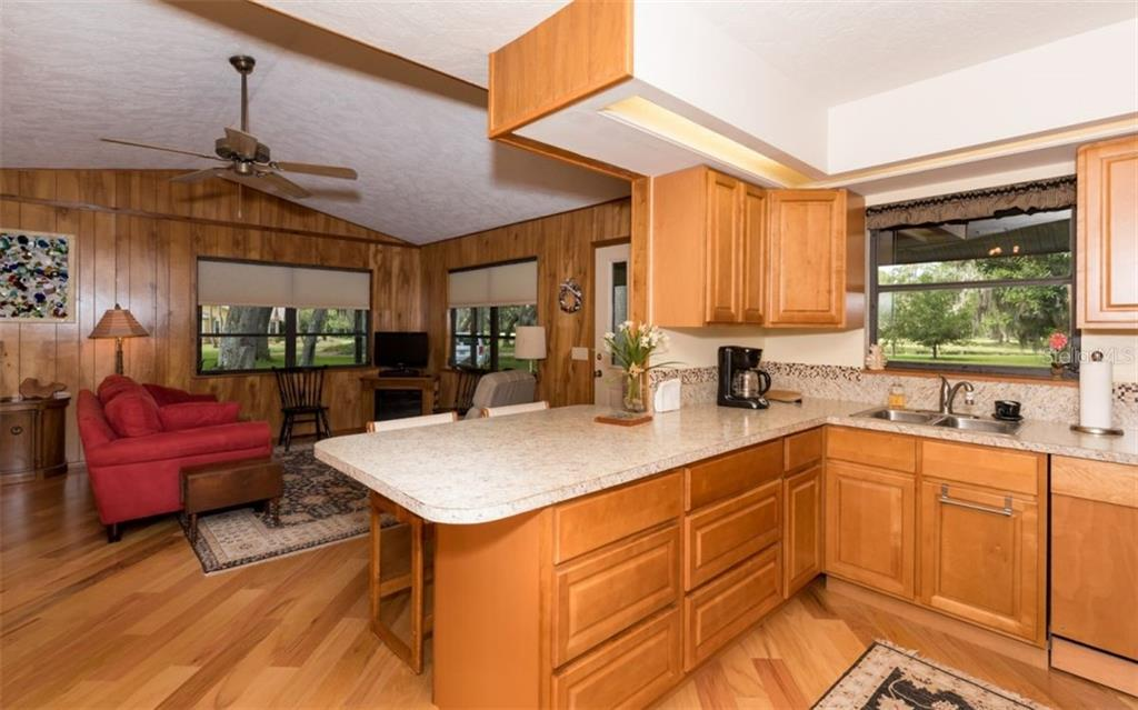 Guest House Kitchen - Single Family Home for sale at 7865 27th St E, Sarasota, FL 34243 - MLS Number is A4400492