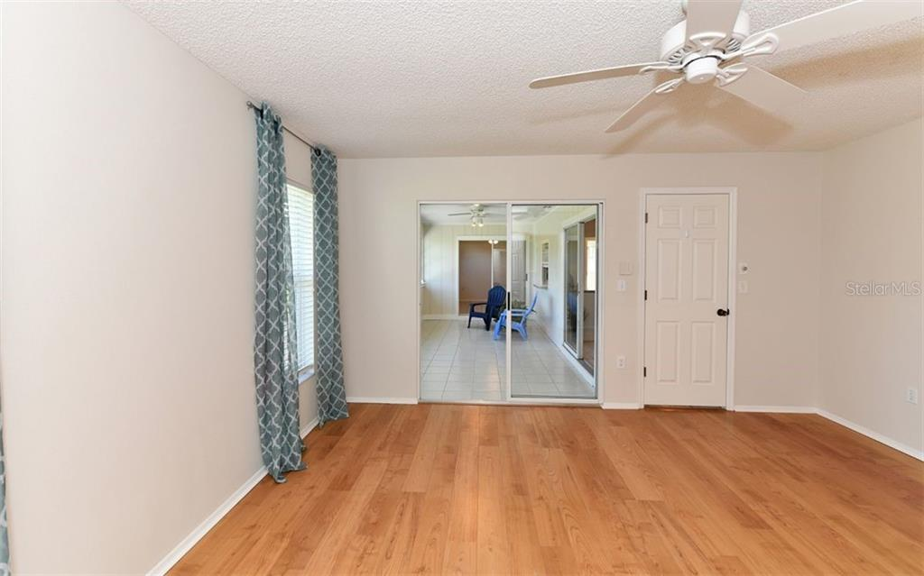 Master Bedroom Suite with doors leading to the Sunroom... - Single Family Home for sale at 6202 65th Ct E, Palmetto, FL 34221 - MLS Number is A4400567