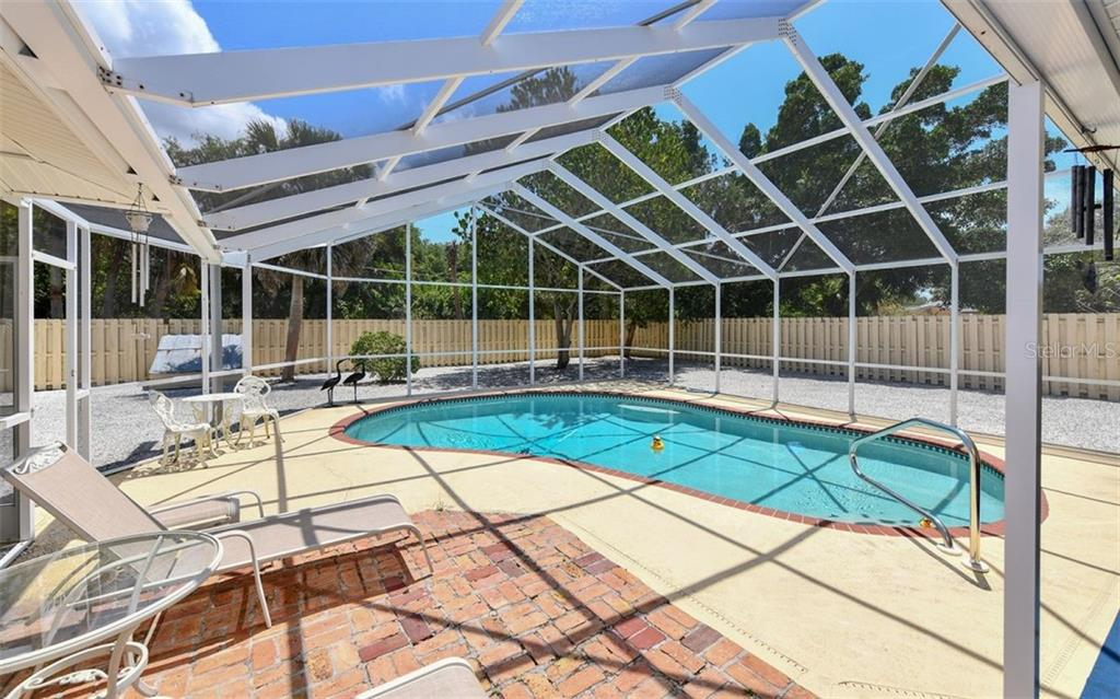 Single Family Home for sale at 5327 Shadow Lawn Dr, Sarasota, FL 34242 - MLS Number is A4401952