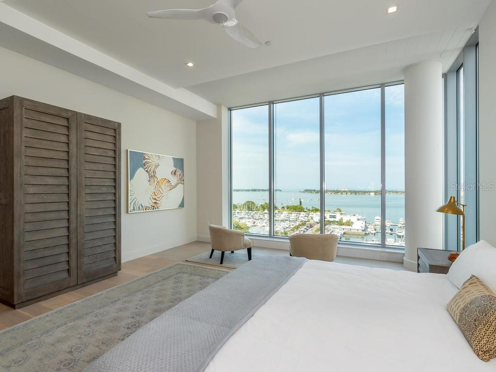 Master bedroom suite with expansive views of Siesta Key, Sarasota, Bay, Ringling Bridge, Golden Gate Point, Gulf of Mexico, and Longboat Key. - Condo for sale at 1301 Main St #1001, Sarasota, FL 34236 - MLS Number is A4402790