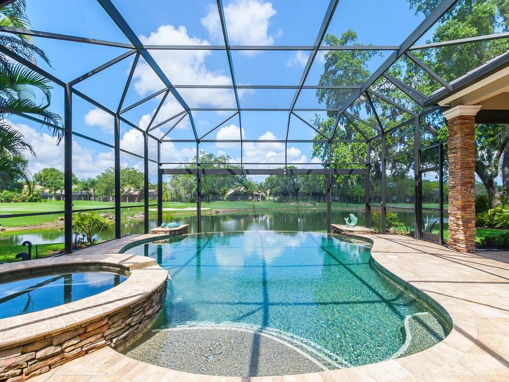 Relax in this infinity edge swimming pool with the feel that the pool water and lake beyond are one. - Single Family Home for sale at 12312 Newcastle Pl, Lakewood Ranch, FL 34202 - MLS Number is A4403090