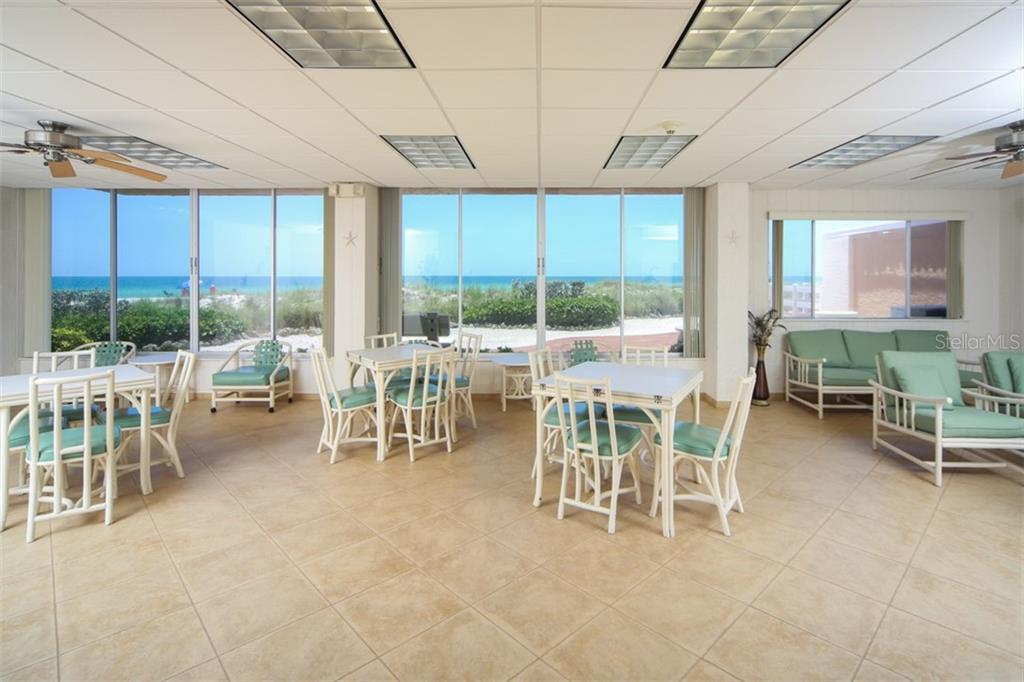 5200 Gulf community room can be rented for family events or to gather with your neighbors for a meal - Condo for sale at 5200 Gulf Dr #101, Holmes Beach, FL 34217 - MLS Number is A4404016