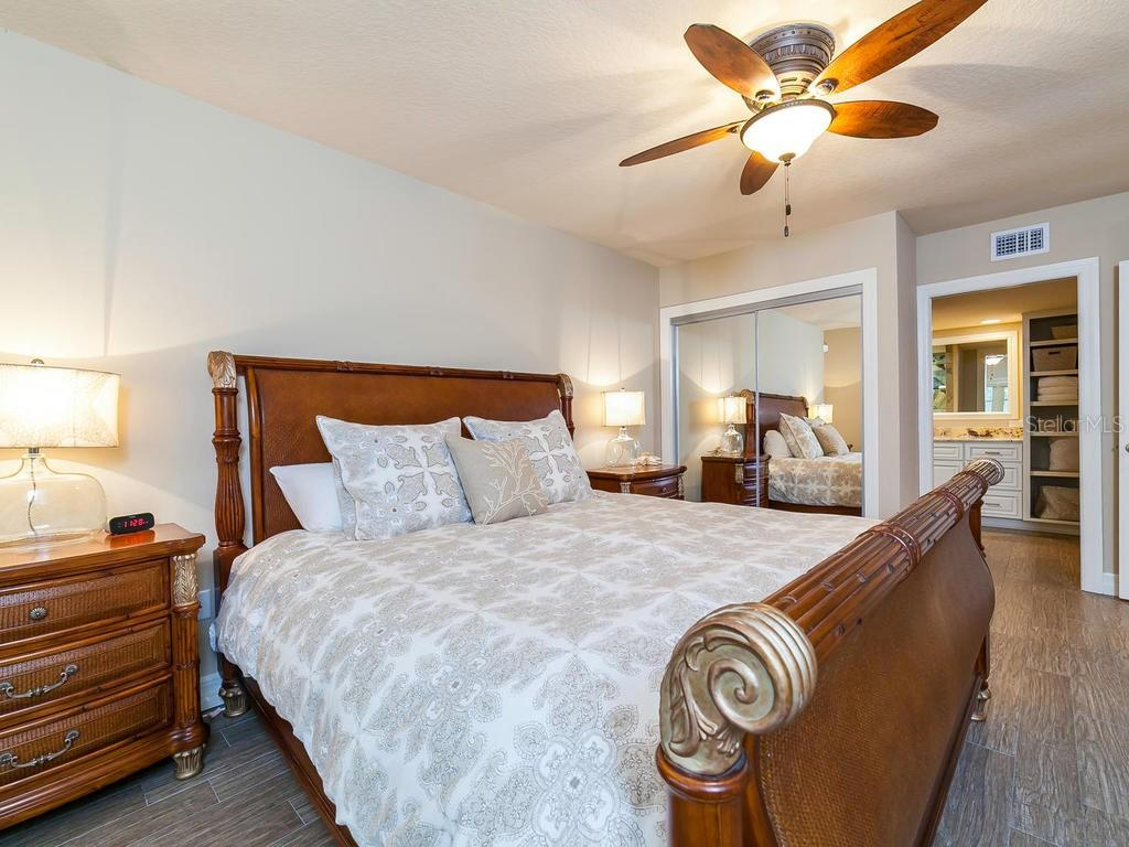 Master Bedroom w Bath en-suite - Condo for sale at 4215 Gulf Of Mexico Dr #103, Longboat Key, FL 34228 - MLS Number is A4404956
