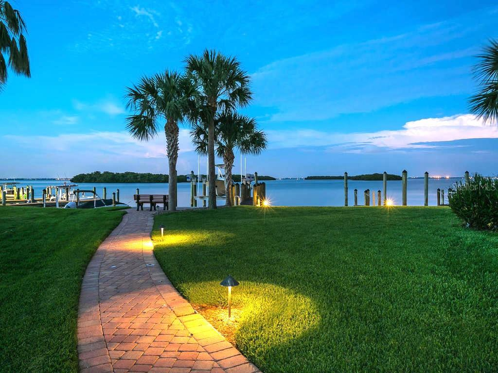Bayside dock at sunset - Condo for sale at 4215 Gulf Of Mexico Dr #103, Longboat Key, FL 34228 - MLS Number is A4404956