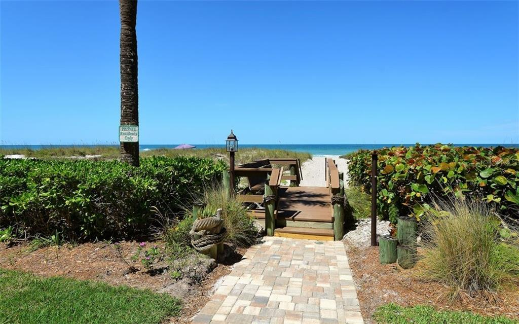 Pavered walk to beach and elevated walk across with a bench to enjoy the sunsets each evening - Condo for sale at 4311 Gulf Of Mexico Dr #601, Longboat Key, FL 34228 - MLS Number is A4405195