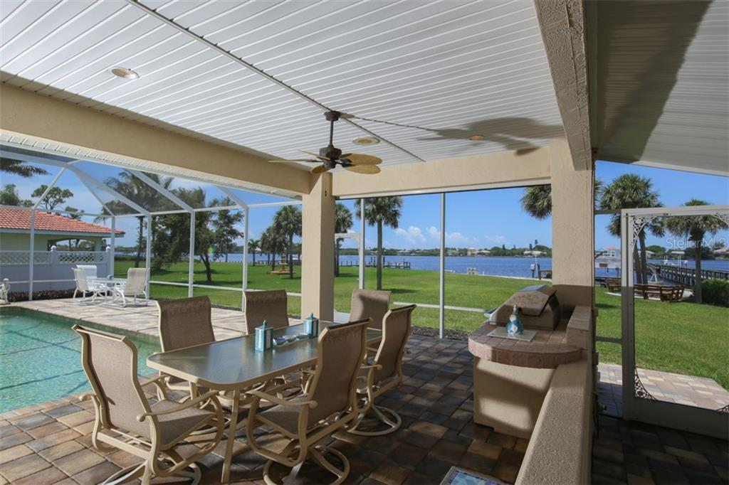 Covered/Screened Lanai with Built-in Grill - Single Family Home for sale at 1778 Bayshore Dr, Englewood, FL 34223 - MLS Number is A4405962