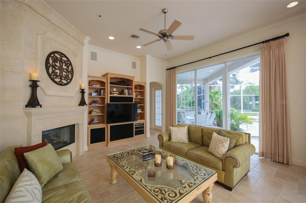 Owner's retreat with tray ceiling, walk-in closet, and views to the lanai. - Single Family Home for sale at 7309 Barclay Ct, University Park, FL 34201 - MLS Number is A4406768