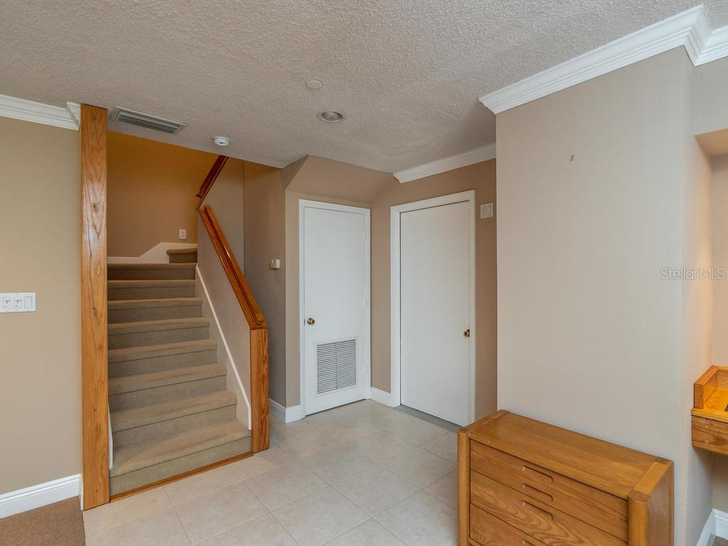 Garage entrance and stairway leading to main living space - Condo for sale at 1912 Harbourside Dr #604, Longboat Key, FL 34228 - MLS Number is A4407777