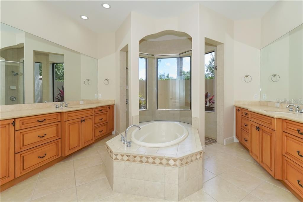 Master Bathroom features a soaking tub, separate master sinks and a walk-thru shower overlooking enclosed garden space. - Single Family Home for sale at 13219 Palmers Creek Ter, Lakewood Ranch, FL 34202 - MLS Number is A4407857