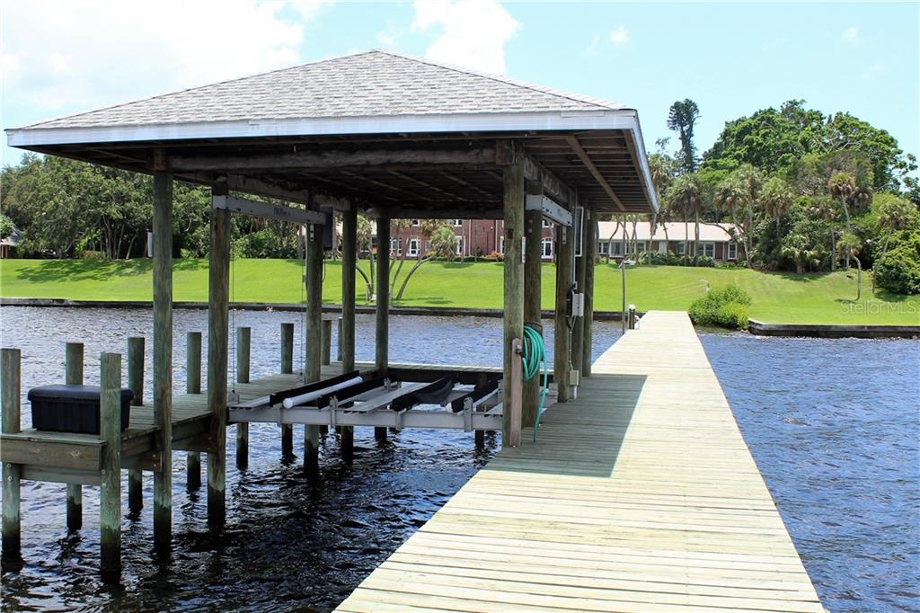 Beautiful 8 foot wide dock with boatport and davits stretches over 300 feet over the River - Single Family Home for sale at 4820 Riverview Blvd, Bradenton, FL 34209 - MLS Number is A4408263