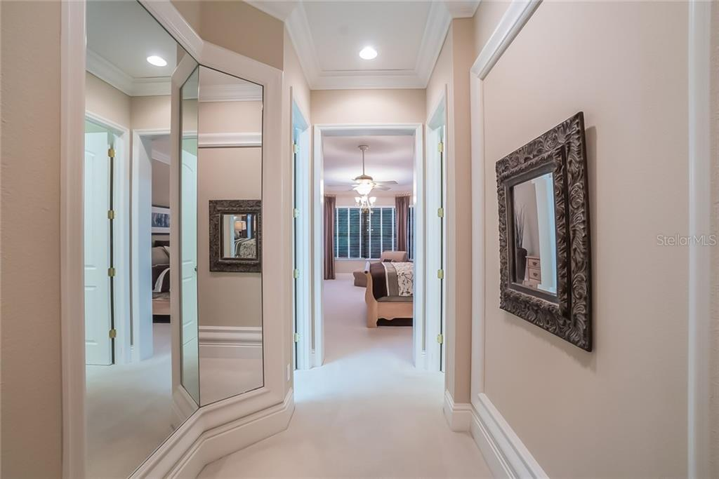 Triple viewing mirrors lead to opposite his/hers LARGE walk-in closets, then into the Master Bedroom suite. - Single Family Home for sale at 13223 Palmers Creek Ter, Lakewood Ranch, FL 34202 - MLS Number is A4408290