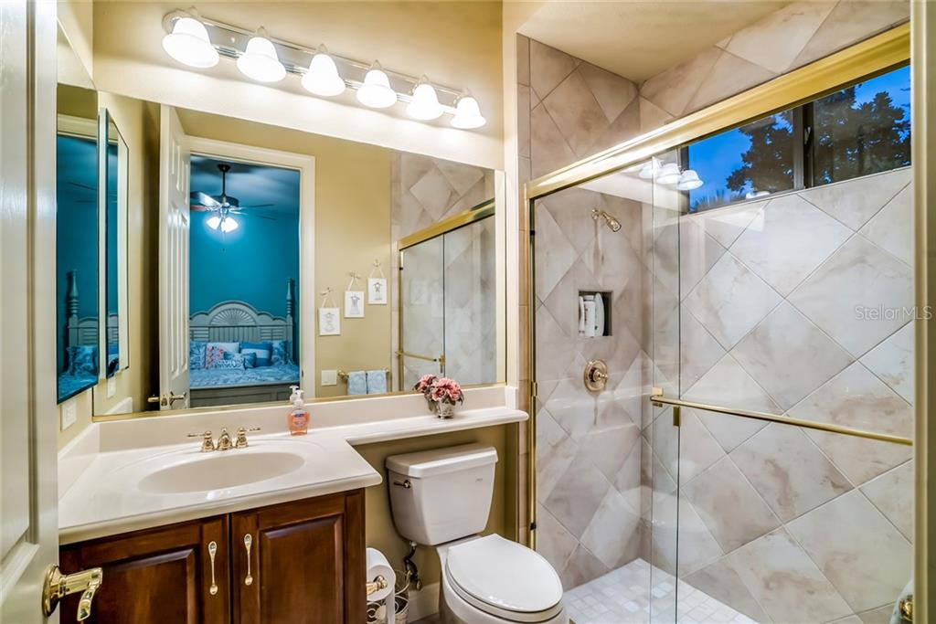 Guest Bathroom 1 of 4 - Single Family Home for sale at 7570 Preservation Dr, Sarasota, FL 34241 - MLS Number is A4409986