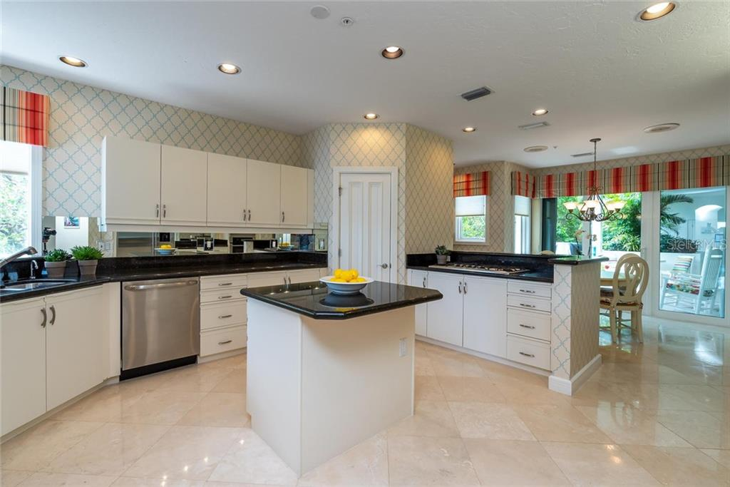 Open kitchen includes GE monogram appliances, Marvel wine fridge, breakfast bar, walk-in pantry, recessed lighting and ample white cabinetry! - Condo for sale at 340 Gulf Of Mexico Dr #116, Longboat Key, FL 34228 - MLS Number is A4411000