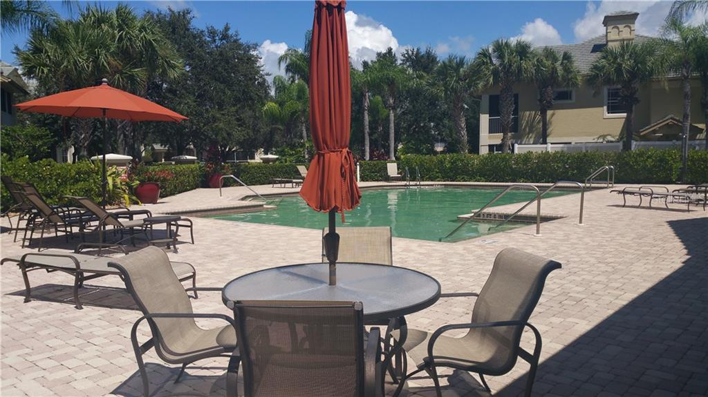 Community pool - Condo for sale at 6516 Moorings Point Cir #202, Lakewood Ranch, FL 34202 - MLS Number is A4413295