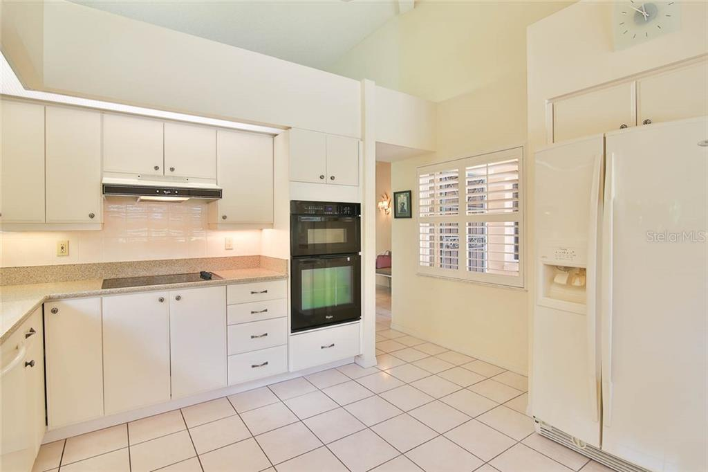 Range is vented to the outside. - Villa for sale at 7686 Calle Facil, Sarasota, FL 34238 - MLS Number is A4413755