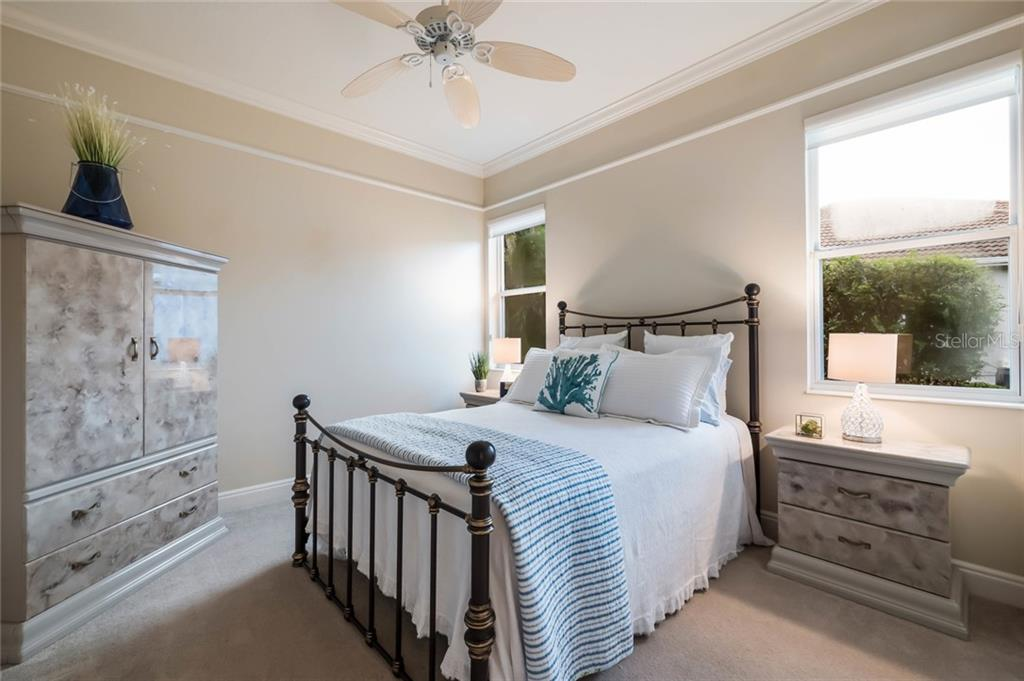 Bedroom 2 of 3 - Single Family Home for sale at 13314 Lost Key Pl, Lakewood Ranch, FL 34202 - MLS Number is A4414050