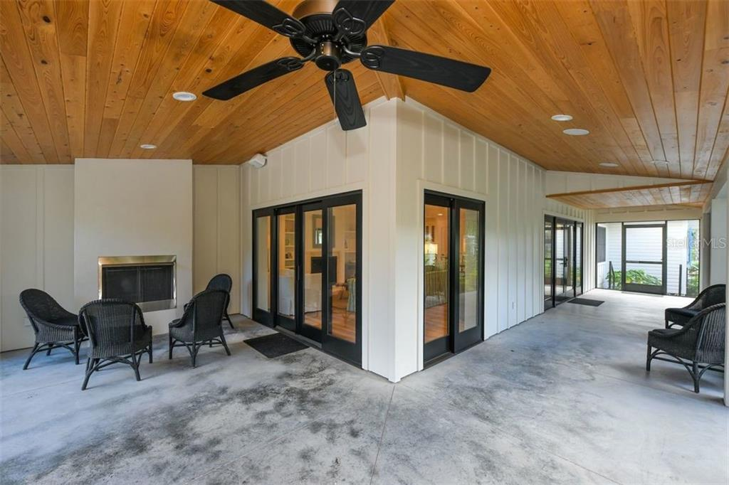 Wrap around screened in porch with gas fireplace. - Single Family Home for sale at 550 Ohio Pl, Sarasota, FL 34236 - MLS Number is A4414310