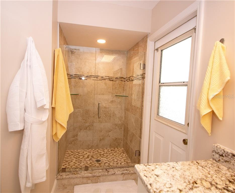 Bathroom #2 with pool access as well - Single Family Home for sale at 5629 Country Lakes Dr, Sarasota, FL 34243 - MLS Number is A4415511