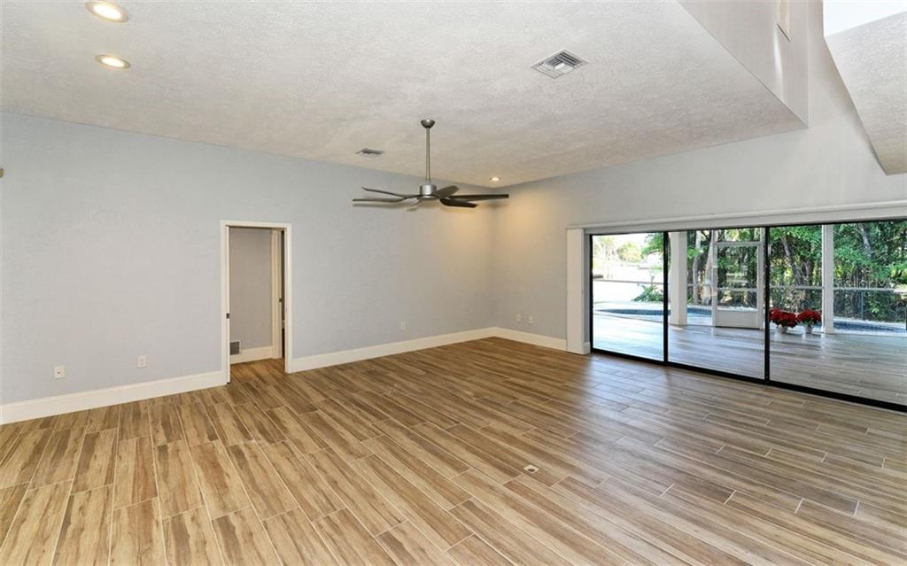 Center island with seating for 6 - Single Family Home for sale at 4619 Higel Ave, Sarasota, FL 34242 - MLS Number is A4415833