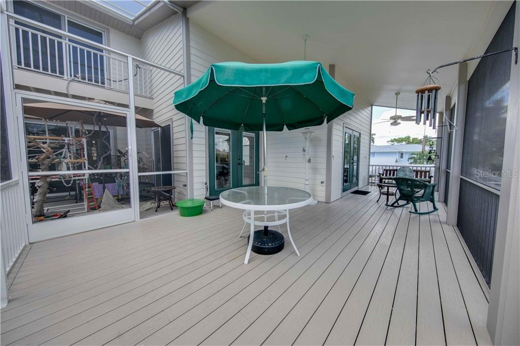 The 2nd floor high performance, composite decking, with doors from the dining area, the great room, and looking up at the master bedroom deck. - Single Family Home for sale at 660 Marbury Ln, Longboat Key, FL 34228 - MLS Number is A4415911