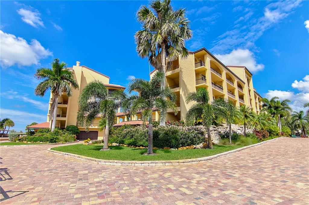 Gulf Side Showing Under Building Parking Entrance - Condo for sale at 8750 Midnight Pass Rd #502c, Siesta Key, FL 34242 - MLS Number is A4416020