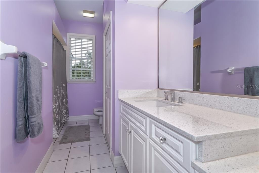 Second Level Guest Bath 2 - Single Family Home for sale at 7698 Albert Tillinghast Dr, Sarasota, FL 34240 - MLS Number is A4416123