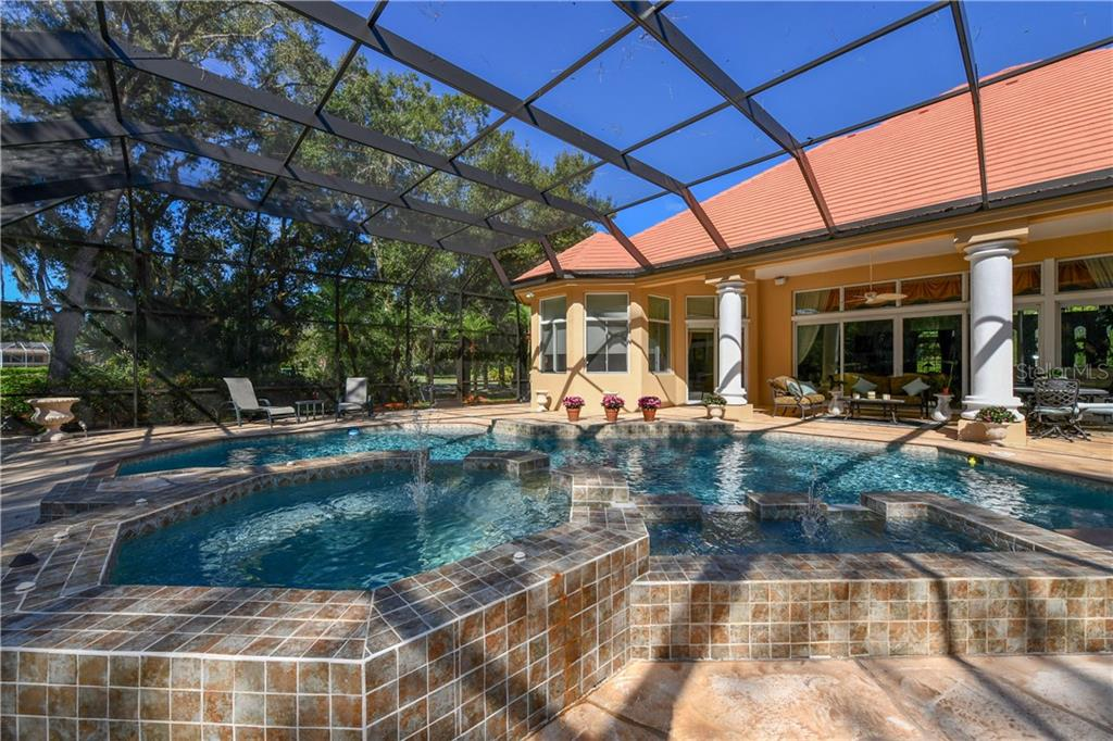 Caged Spa and Fountain - Single Family Home for sale at 7659 Alister Mackenzie Dr, Sarasota, FL 34240 - MLS Number is A4416607