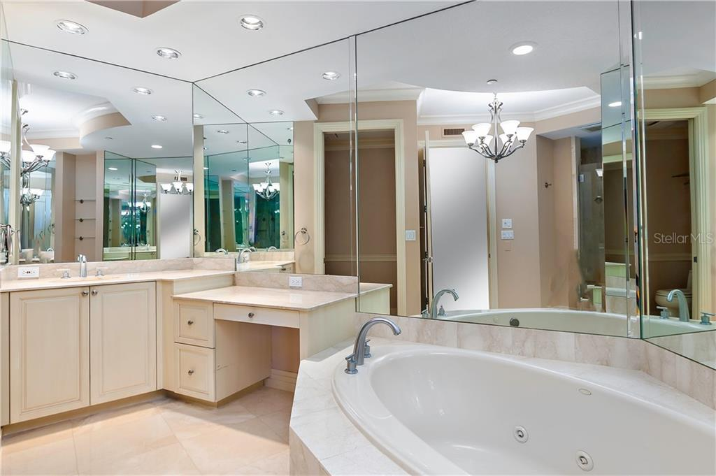Large Master Bath with separate shower, his and hers sinks and vanity - Condo for sale at 990 Blvd Of The Arts #1102, Sarasota, FL 34236 - MLS Number is A4417004