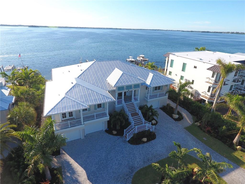 Bayside view of dock with home under construction, photos from 11/2018. - Single Family Home for sale at 639 Key Royale Dr, Holmes Beach, FL 34217 - MLS Number is A4417514
