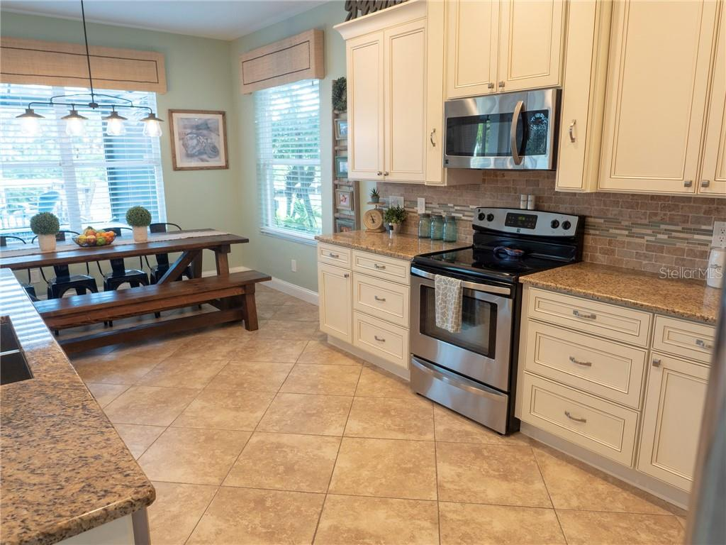 Top notch craftsmanship and design is evident in every detail of this incredible kitchen. - Single Family Home for sale at 3803 5th Ave Ne, Bradenton, FL 34208 - MLS Number is A4417524