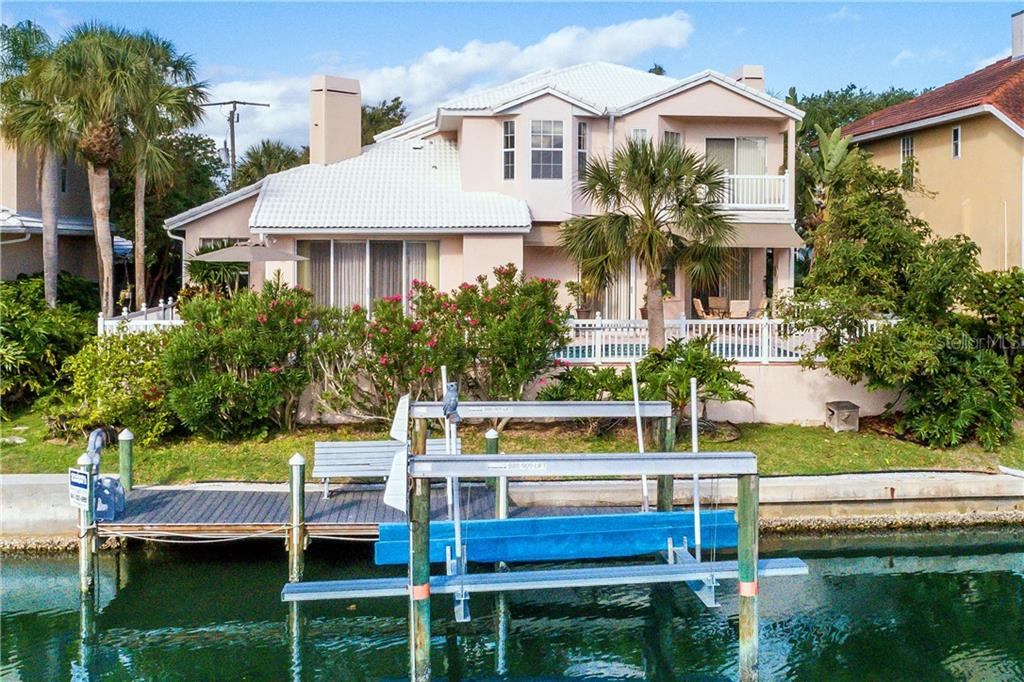 Exterior rear with dock - Single Family Home for sale at 4963 Oxford Dr, Sarasota, FL 34242 - MLS Number is A4417783