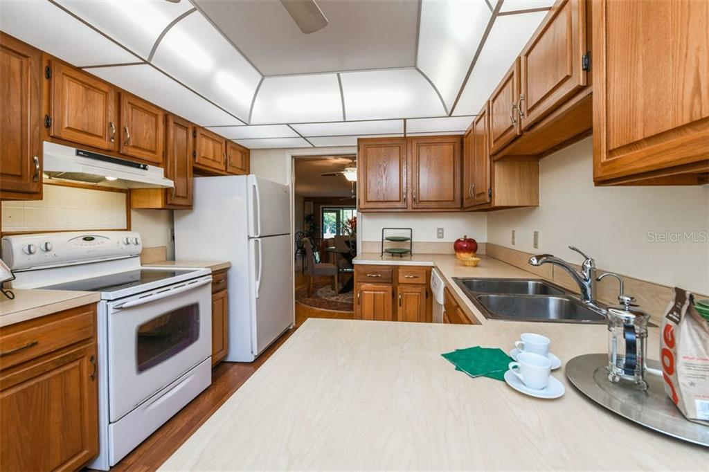Nice big eat-in kitchen with wood laminate floor. Lots of counter space and cabinets too. - Villa for sale at 3617 Gleneagle Dr, Sarasota, FL 34238 - MLS Number is A4417832