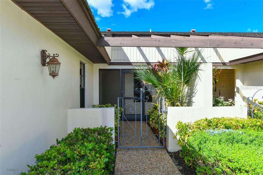 Beautiful entryway with screened lanai. - Villa for sale at 3617 Gleneagle Dr, Sarasota, FL 34238 - MLS Number is A4417832
