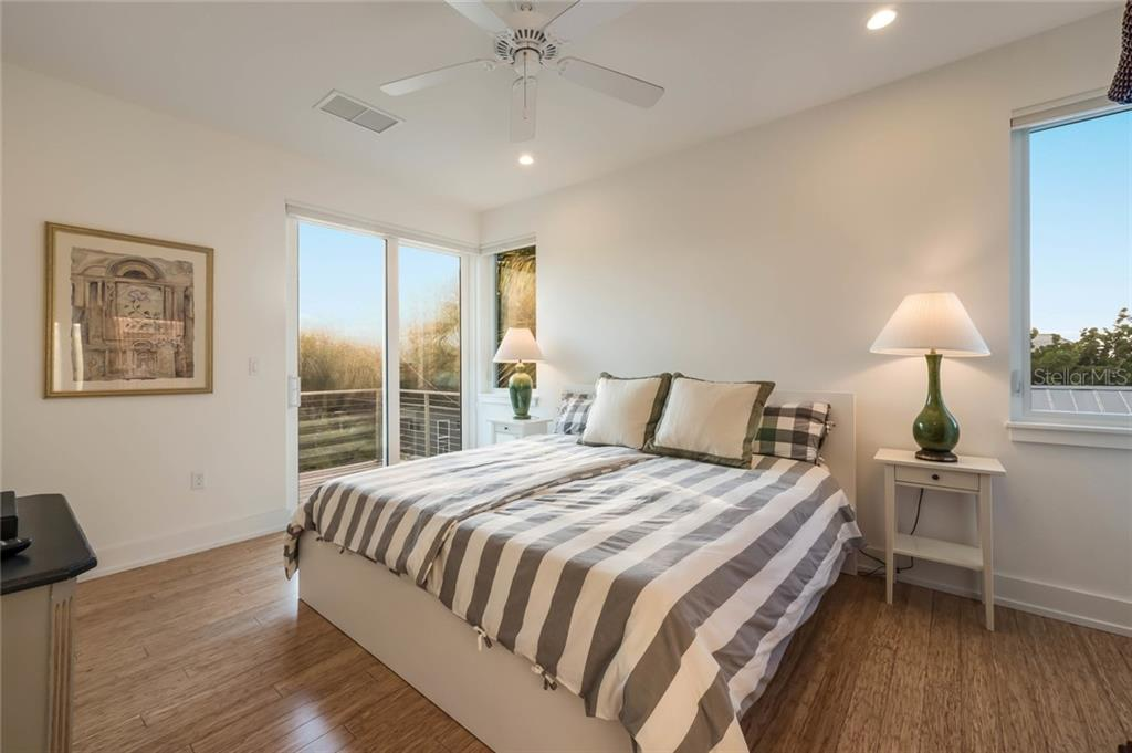 Bedroom #1 - Single Family Home for sale at 7130 Longboat Dr E, Longboat Key, FL 34228 - MLS Number is A4418105