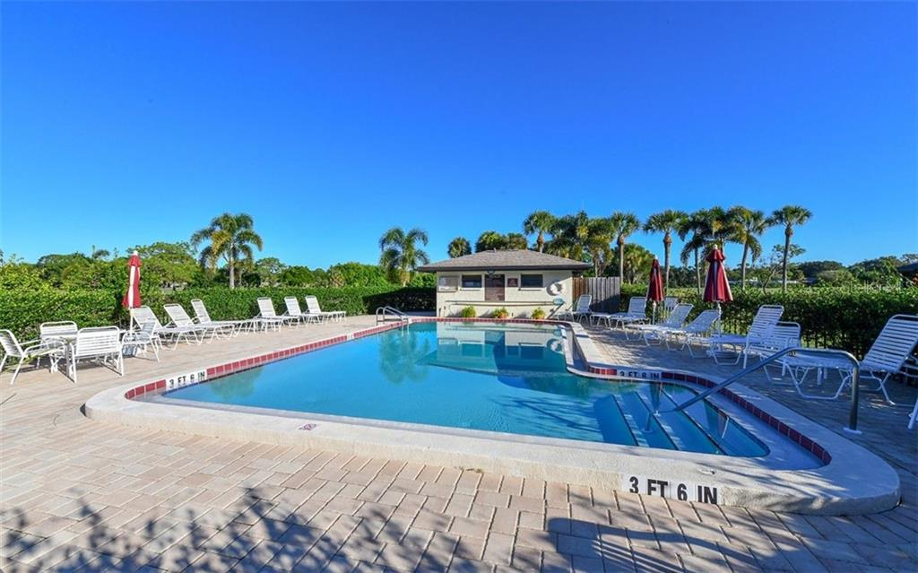 Lovely, well-maintained pool offers outside shower and restrooms - Condo for sale at 4576 Longwater Chase #59, Sarasota, FL 34235 - MLS Number is A4418168